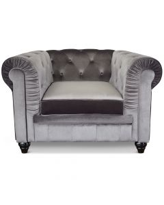 Le véritable fauteuil Chesterfield capitonné velours argent